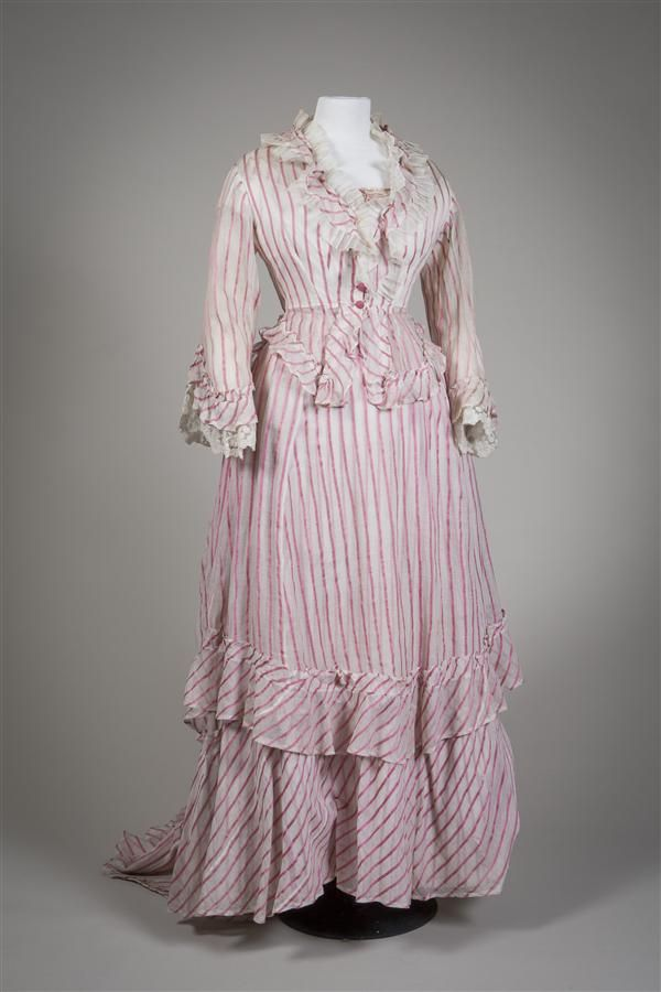 Early 1870s dress from the Netherlands. Gauzy white muslin with woven stripes of pink silk. Four-part ensemble consisting of day body, evening body, skirt, and overskirt. Gemeentemuseum Den Haag.