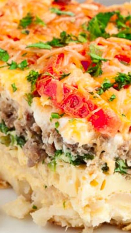 Hash Brown Tomato Breakfast Caserole ~ Soft, tender potatoes enveloped in cheesy goodness.  Savory browned sausage.  Roasted tomatoes on top...  Easy peasy, delicious, mouthwatering dish