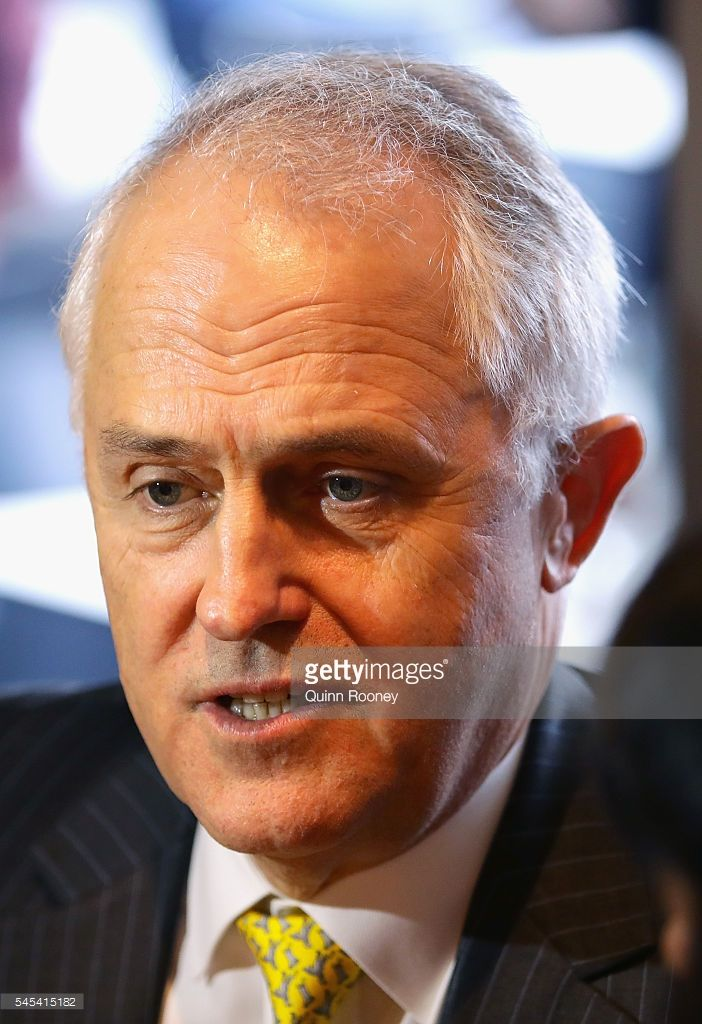 Prime Minister Malcolm Turnbull chats as he has coffee with Julia Banks and her family at Vanilla Cafe on July 8, 2016 in Oakleigh, Australia. The Prime Minister is meeting with members around Australia to sure up support for the Coalition as counting continues following election night on Saturday. After results were too close to call a winner on the night, postal votes continue to be counted to determine who claims majority victory.