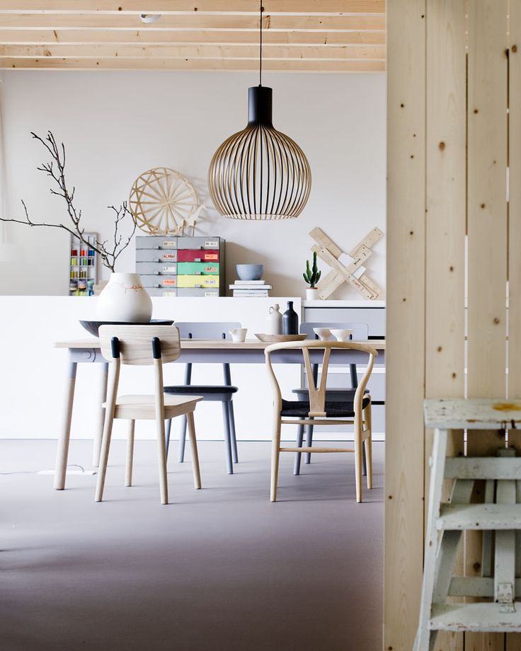 Octo 4240 lamp by Secto Design, looking good with the wooden ceiling & walls. Photo by Jeroen van der Spek.