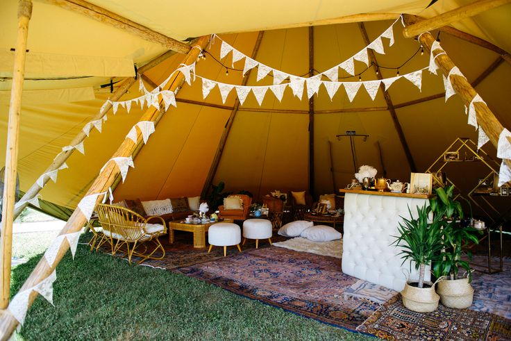Mid Century Modern Lounge Furniture and Bar | Bohemian Textures and Warm Tones | Layered Rugs and Mismatched Vintage Decor | Indie House Teepees | Pearl Snap Hall Open House 2017 | via Birch & Brass Vintage Rentals for Weddings and Special Events in Austin, TX