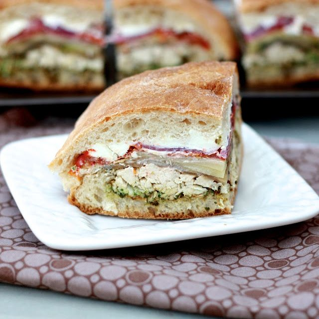 pressed sandwiches with chicken, roasted veggies, goat cheese, & pesto--perfect picnic food!