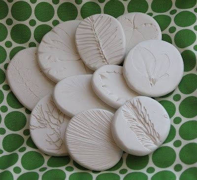 nature sculptures & salad spinner art  Use clay let harden paint prints