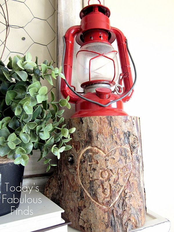 Grab a log, carve a heart and top with a lantern for fun Valentine's Day outdoor porch decor! via Today's Fabulous Finds