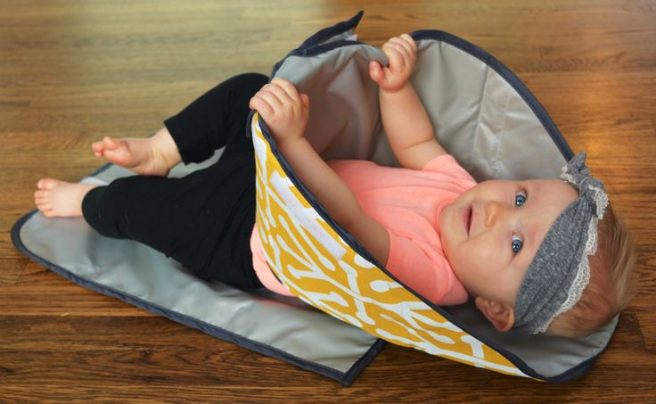 This new diaper changing pad helps keep those curious little hands out of the…
