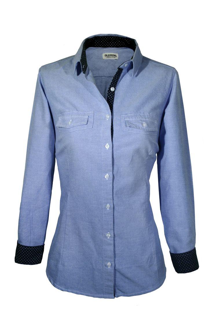 Camisa mujer Oxford lisa azul, con detalles en los puños y cuello con topos blancos. 100% algodón www.oldridel.com