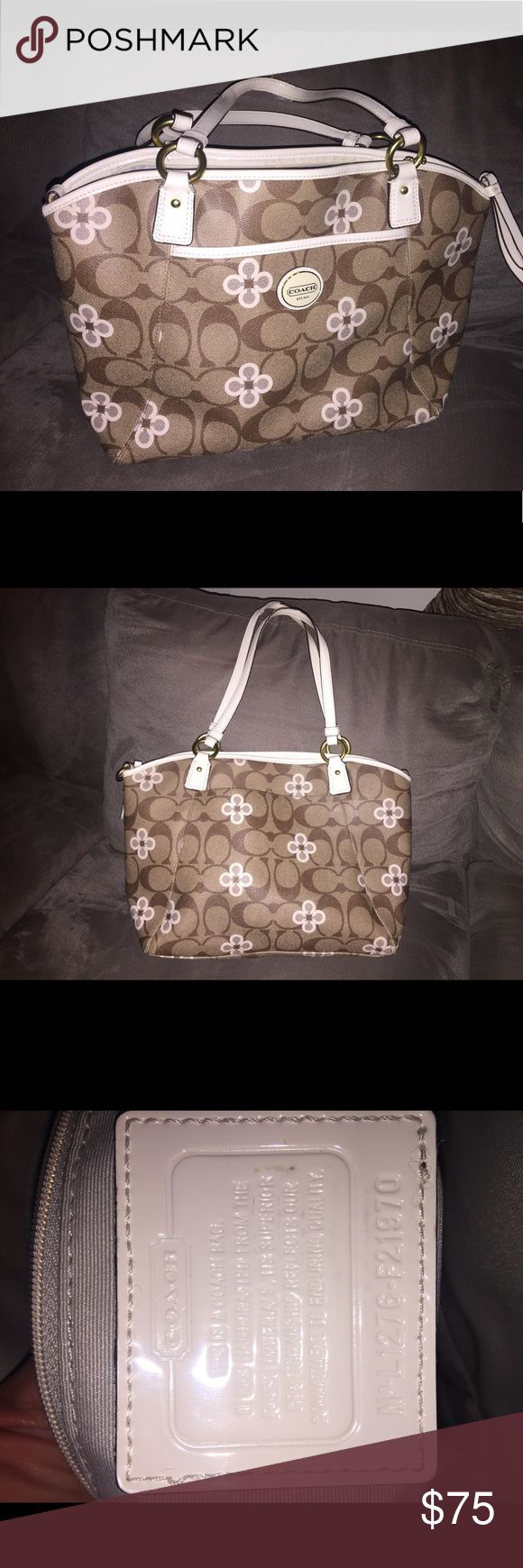 Medium size Coach tote Medium sized Coach tote.  Barely used.  No stains or scuffs.   Has pockets inside and out and comes with the shoulder strap.   Super cute! Coach Bags Totes