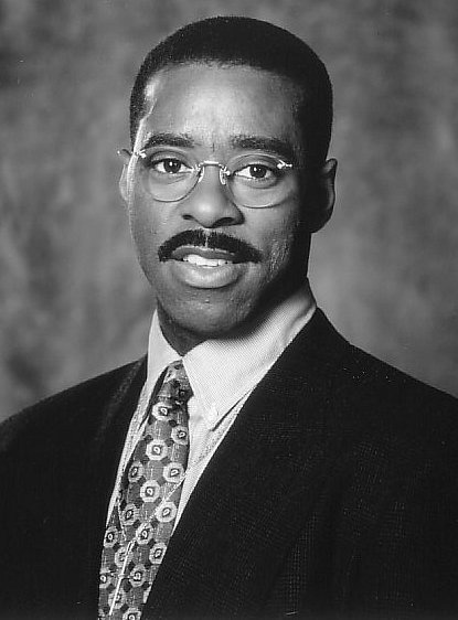 """Courtney B. Vance as Reverend Henry Biggs in 1996's """"The Preacher's Wife"""" w/ Whitney Houston"""