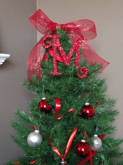 Place a sparkly letter at the top of your tree to proudly display your family initial.  $13.50, etsy.com