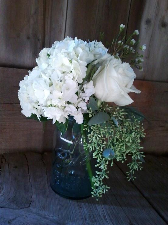 Hydrangea rose waxflower eucalyptus in a vintage blue