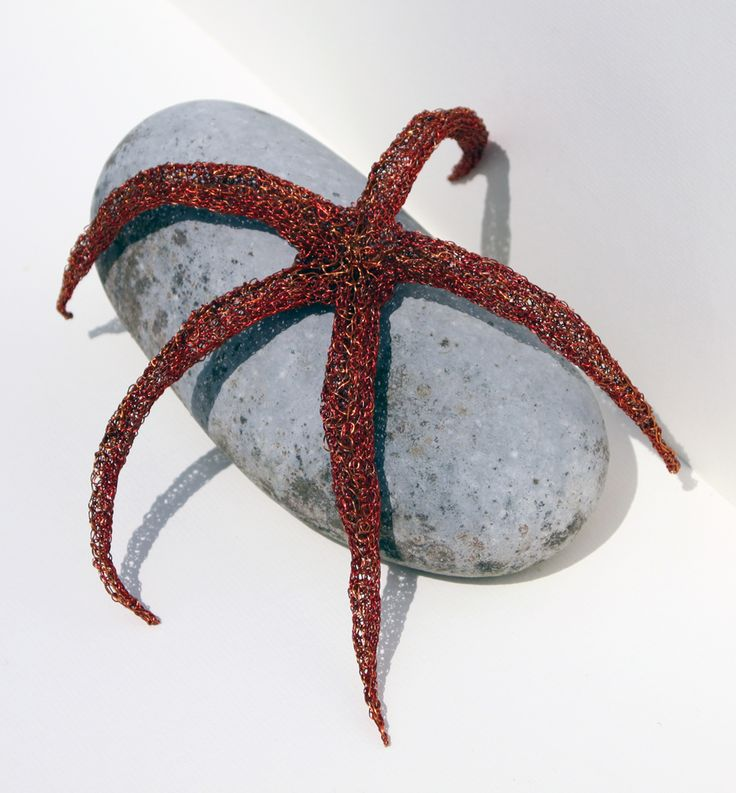 Sea star. It's not a fish. Knitter recycled copper wire from an electric motor. 30cms in cir. 3cms high.