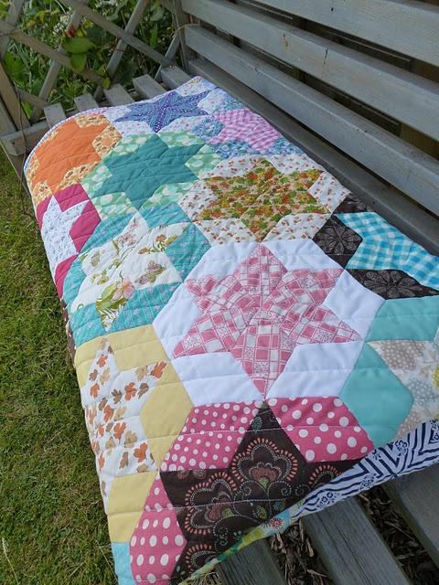This quilt is entirely paper pieced. The quilter provides tutorials.
