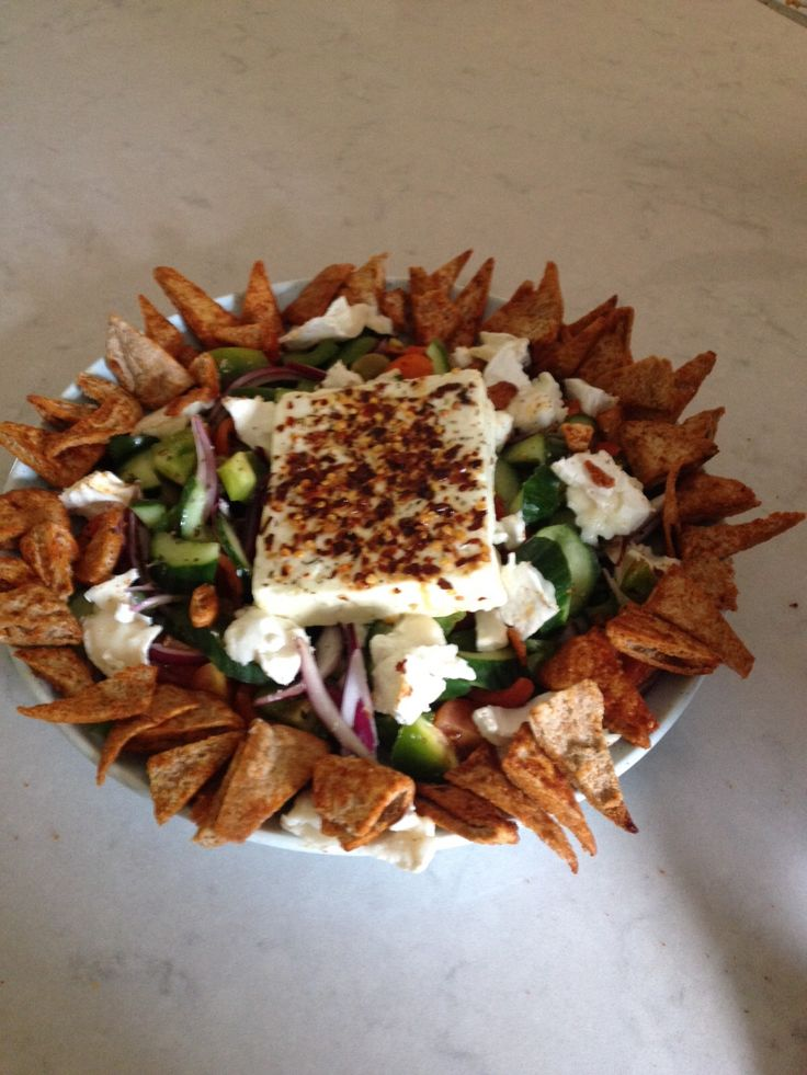 Greek Salad with baked feta and pitta chips  recipe- http://tiffinandteaofficial.com/feta-salad-with-paprika-pitta-chips/