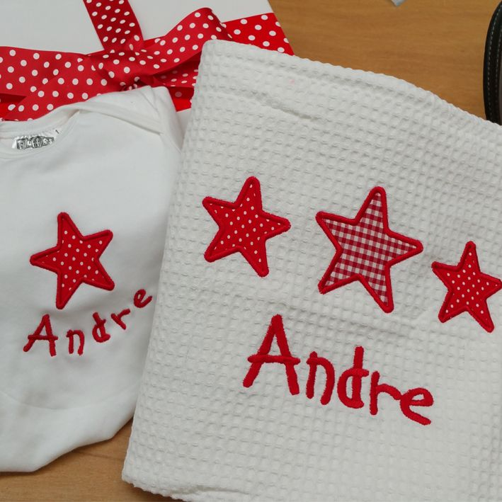 Red stars for baby Andre on his own personalised 100% cotton baby blanket.
