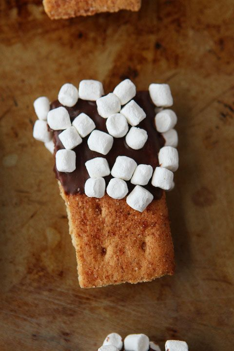 Super fun for an indoor camp out! S'mores Mini Dippers. #smores #food #chocolate #marshmallows #dessert #camping #cookies