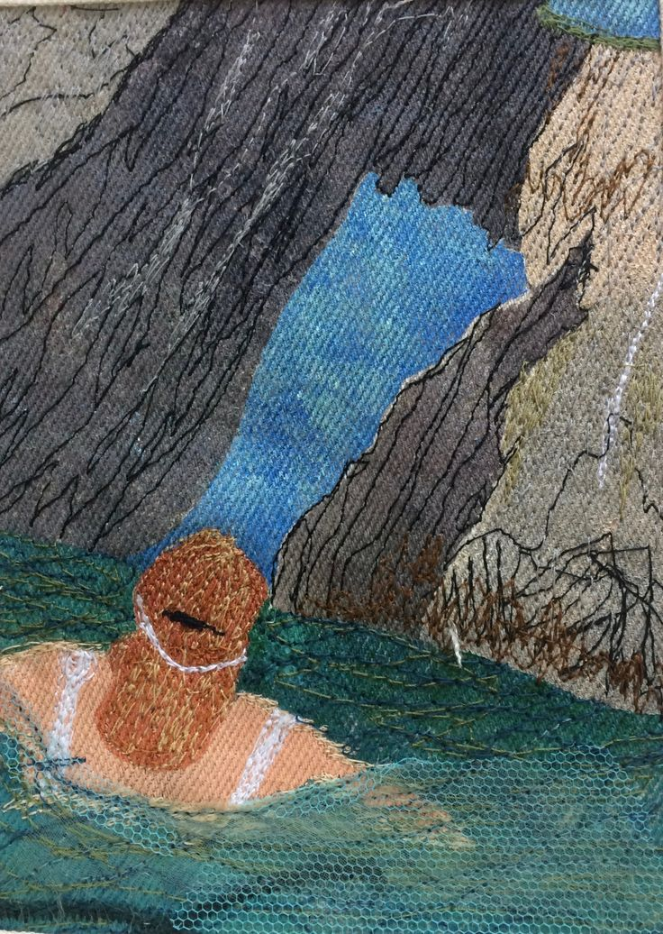 Queenie swimming towards Natural Arch, Torquay by Jackie Wills. Inspired by a photo by Sophie Pierce. Hand painted, machine embroidered panel.  This is a series of four panels created for my swimming friends.