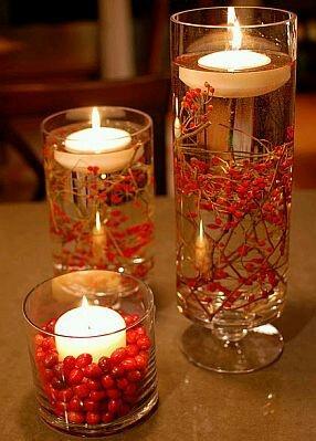 Centros de mesa vela flotante, con detalles en rojo