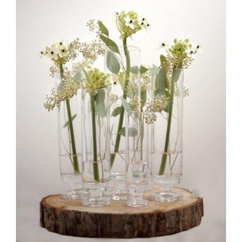 Boom schijf als onderzetter met bloemen vaasjes. Boomschijven verkrijgbaar op webshop decoratietakken