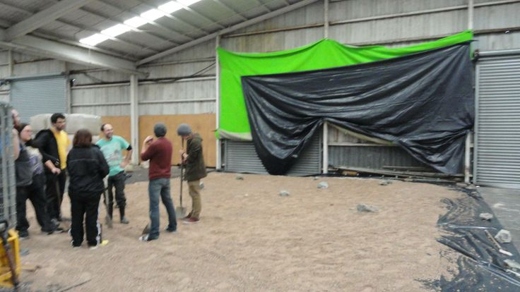 Physical Realm Studio are back into filming this weekend! We have had to change our loaction because of weather issues and we are now filming everything in a big warehouse using our portable greenscreen! Here's a photo of the crew preparing the ground for filming in the warehouse! Keep checking us out on the progress of the Bones of Essimer!!!!!