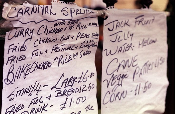 A menu of showing some of the food available at the Notting Hill Carnival 2000 in London. Ref #: PA.1335925  Date: 28/08/2000