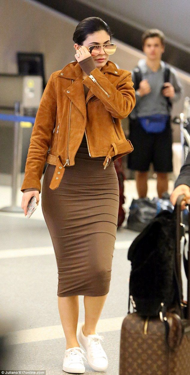 So chic: Kylie wore a skintight brown dress and suede leather jacket as she covered her face with a pair of dark sunglasses