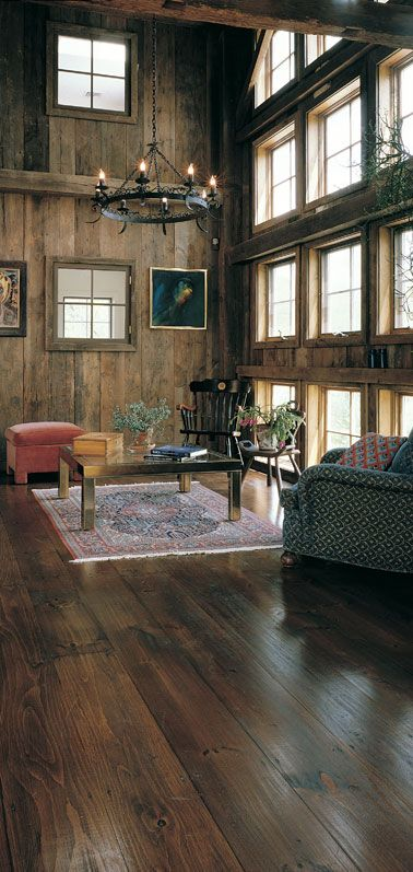 Reclaimed Barnwood floors. The laminate in our new place looks just like this.  I'm in love with it!