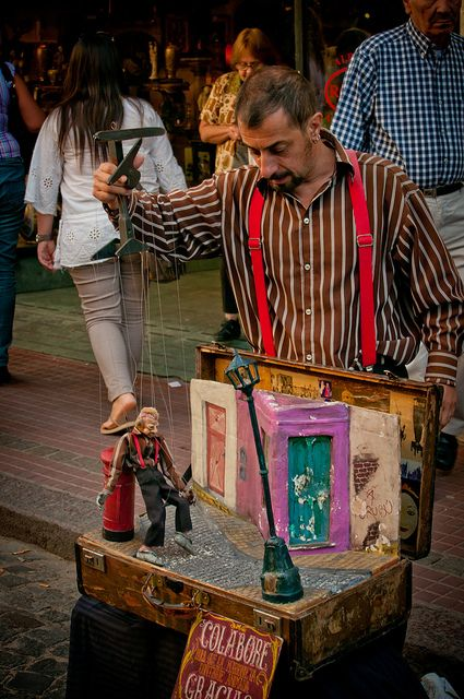 A street performer/puppeteer wows the crowd with his skills in San Telmo, Buenos Aires.