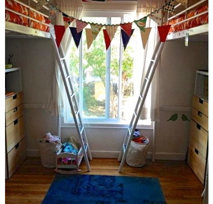 2 loft beds from Ikea make room for play and storage underneath in this small kids room.