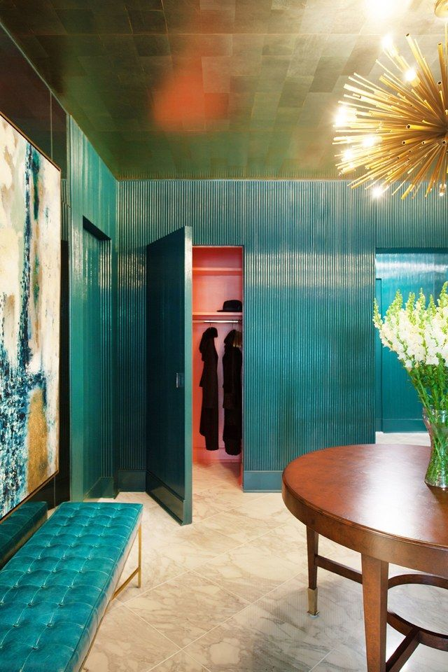 The entryway walls are painted w/Benjamin Moore's Teal Ocean. And the ceiling is covered in platinum leaf blocks.