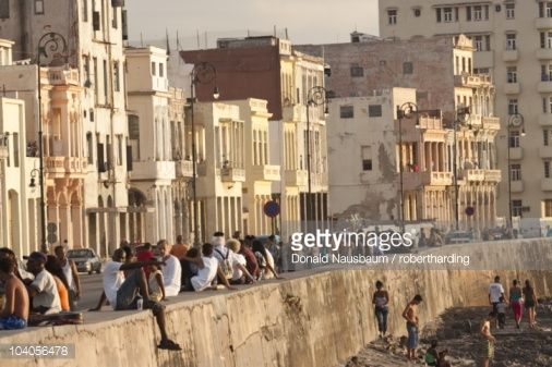 Stock Photo : Crowds of people sitting on sea wall on the Malecon, in Havana, Cuba, West Indies, Central America