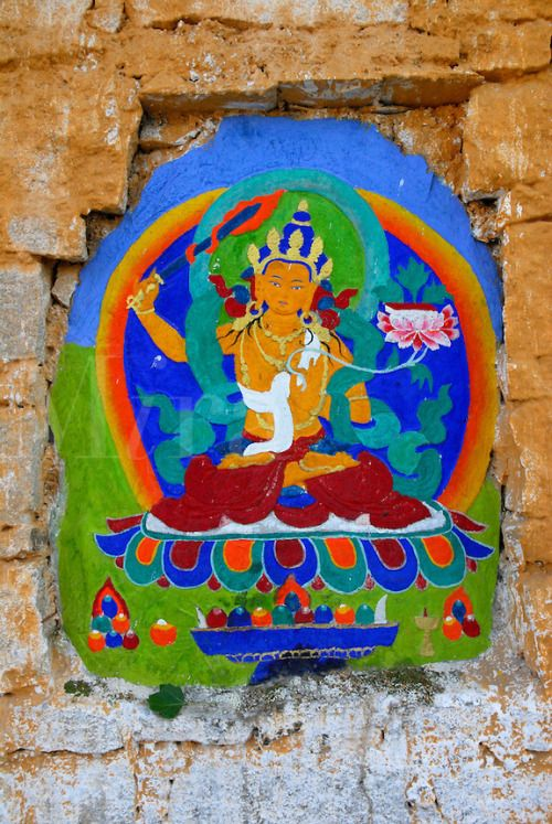 Jampelyang, Bodhisattva of Wisdom, teacher of Buddhist doctrine, holds flaming sword of awareness to cut through ignorance, and lotus, painted on the outer wall of the Potala Palace, along the Tsekor, the pilgrim circuit that encircles the Potala, Lhasa, Tibet, China