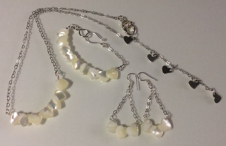 RESERVED Mother of pearl heart necklace, earrings & bracelet set - mother of pearl jewellery - jewellery set - white jewellery by OnyxlyItsBeautiful on Etsy https://www.etsy.com/listing/244634794/reserved-mother-of-pearl-heart-necklace