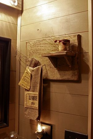 primitive shelf in bathroom