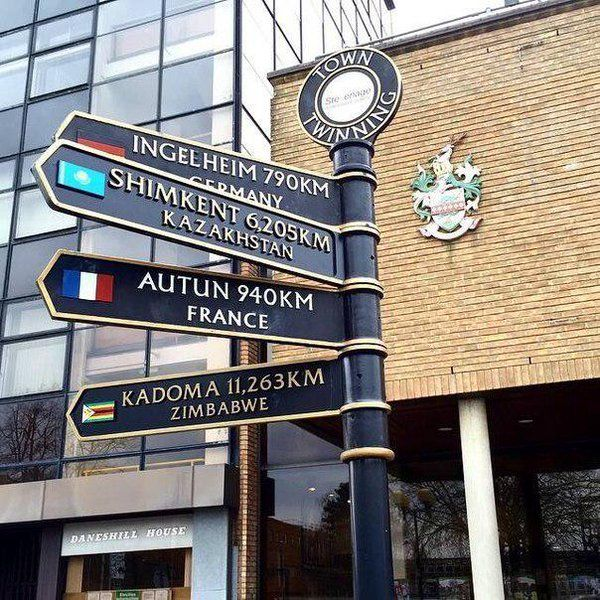 HERTFORDSHIRE – Stevenage, England, Great Britain, UK. This town is twinned with Ingelheim am Rhein in Germany, Shymkent in Kazakhstan, Autun in France, and Kadoma in Zimbabwe. The sign is on Danestrete in front of Stevenage Borough Council. https://www.google.ca/maps/place/Stevenage+Borough+Council/@51.9014064,-0.2056888,17z/data=!4m5!3m4!1s0x487631ce23b695c7:0x4f2d66bca0a051cf!8m2!3d51.901404!4d-0.203497
