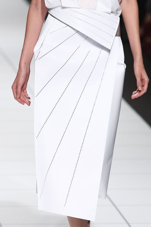 White skirt with crisp folds & perforated lines; architectural fashion details // Issey Miyake