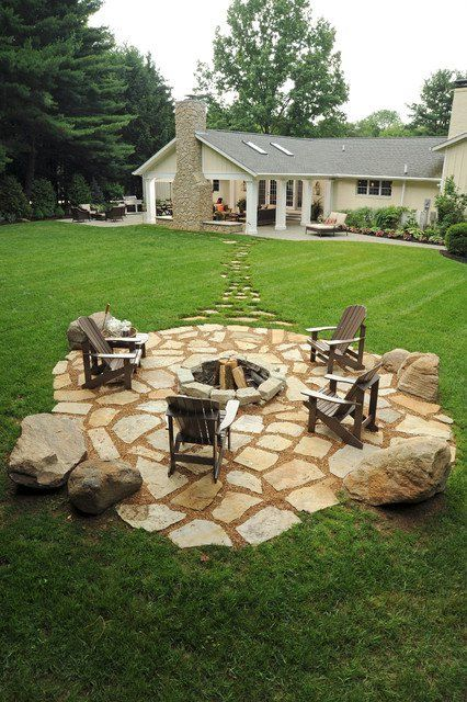 Not the fire pit, though that is a lovely idea, but extending the roof like you seen in the background by the house, to make a covered but open area with a fireplace. Love it!