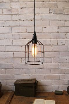 Pendant Cage Light In Black Used As A Ceiling Above Desk