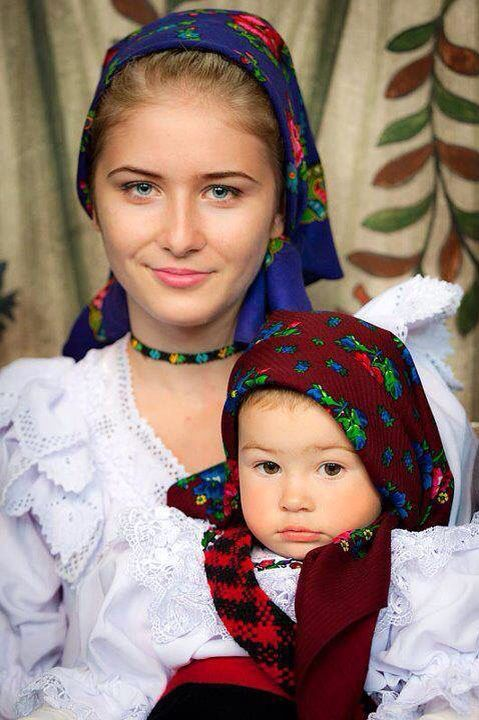Proud Romanian mother and daughter in their traditional outfits