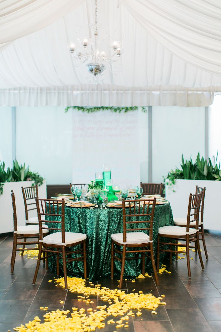 Reception table for Wizard of Oz theme wedding. Emerald