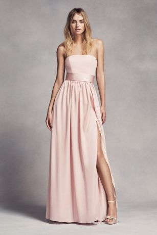 This floor-length crepe and charmeuse bridesmaid dress exudes sophistication with a straight strapless neckline and satin trapunto-stitched belt at the waist.   White by Vera Wang, exclusively at David's Bridal  Polyester  Back zipper; fully lined  Dry clean  Imported