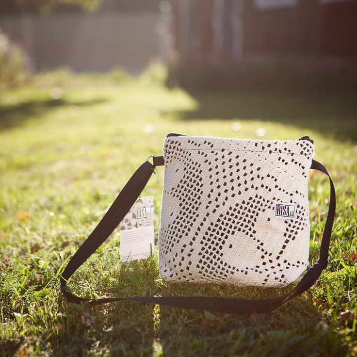 Risakos little shouldebag is made of recycled lace in Finland.