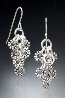Handmade+sterling+silver+earrings+-+circles+with+a+sterling+silver+daisy+attached+to+each+-+perfect!++From+the+Elegant+Collection.++These+earrings+come+to+you+in+a+gift+box,+as+shown.++++Clean+using+our+polishing+cloth+or+your+own+silver+dip.+Made+in+the+USA.++Free+shipping+in+the+US.++Questions?+Email+me+-+I+would+love+to+hear+from+you.