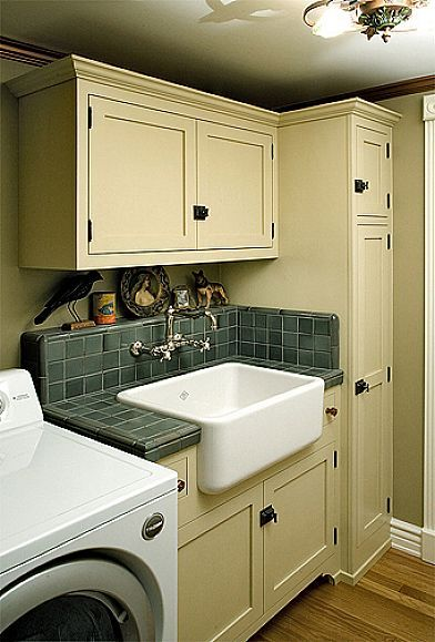 Pin by misti thompson on house pinterest for Cheap laundry room cabinets