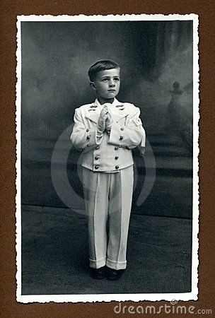 This original antique photograph is of a young boy at his first communion, taken in Italy.
