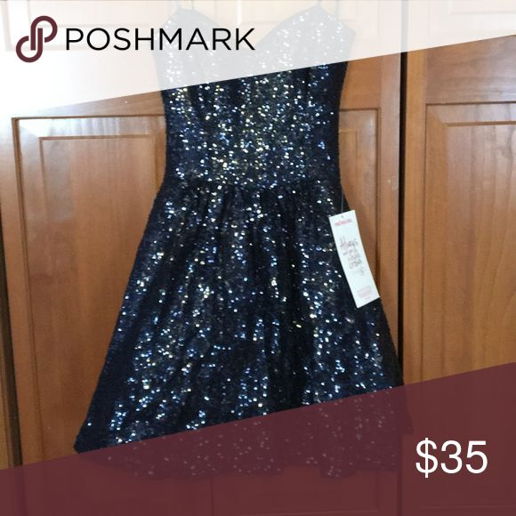Navy blue prom homecoming dress Navy blue strapless dress. New with tags from Prom Girl. Sequence dress. Size 5/6. Smoke free home. Dresses Strapless