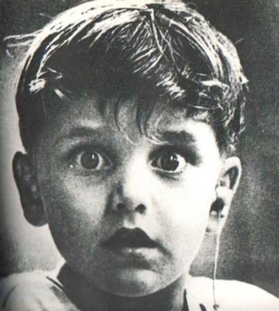 40 of the Most Powerful Pictures Ever Taken  Harold Whittles hears for the first time ever after a doctor places an earpiece in his left ear.