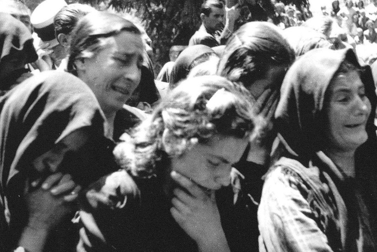 Kalavrita, 1943.  Wives, mothers, daughters and orphans mourn. Wehrmacht Troops executed all 800 of the male population and set the houses on fire.