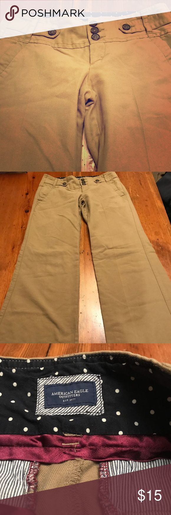 AE khakis!!! These are med color khaki and materials as pictured!! Cute pair! Low cut and flare/trouser!! Good condition! Make offer or bundle and save! American Eagle Outfitters Pants Boot Cut & Flare