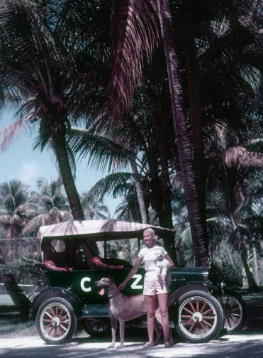 """C.Z. Guest in Palm Beach, FL with her """"C.Z."""" initialized car and 2 dogs. Photographed by Slim Aarons ca. 1955"""