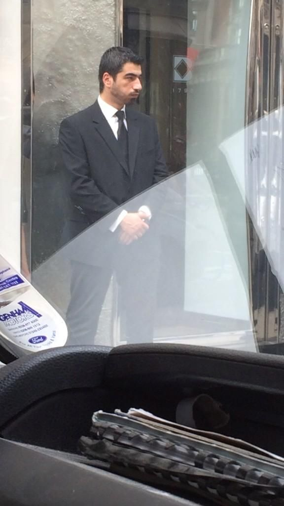 Caption This: Is this Luis Suárez disguised as doorman?
